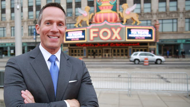 Christopher Ilitch, of Ilitch Holdings, Inc. , stands in front of the Fox Theatre marquee, during the relighting event in Detroit on Thursday, Oct. 15, 2015.
