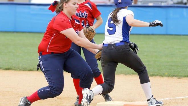 Binghamton first baseman Elena Shelepak tasgs out Alissa Rice of Horseheads during Thursdays STAC game in Horseheads.