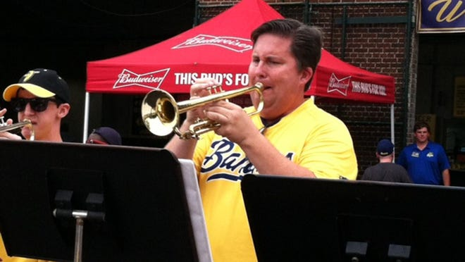 South Effingham High School marching band director Sean McBride plays the trumpet last summer as part of the Savannah Bananas pep band. McBride expects school officials to provide some guidance for the Mustangs marching band practices, which kick off in full swing in July.