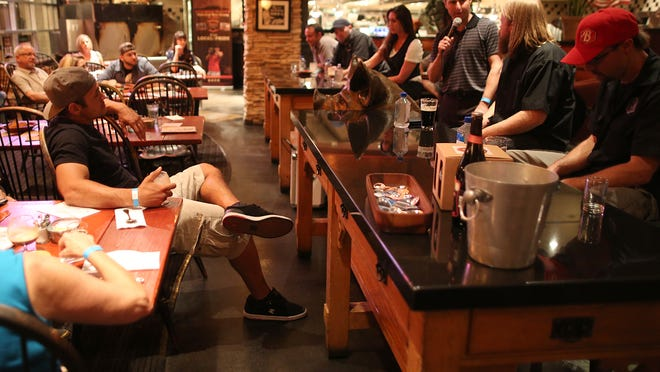 News Editor James Meier (holding microphone) opens up a Q&A with a beer expert panel as Lift Your Spirits visits Babe's Bar-B-Que and Brewhouse at The River in Rancho Mirage, Wednesday.