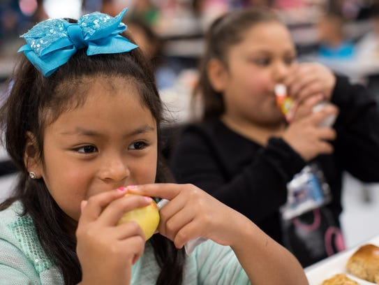 Aubrilynn Cuestas eats an apple during lunch Thursday,