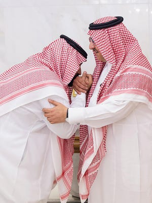 A handout photo made available by the Saudi Press Agency shows Saudi Crown Prince Mohammad bin Salman. left, kissing the hands of his cousin, former crown prince Mohammad bin Nayef, as a sign of respect  on June 21, 2017.