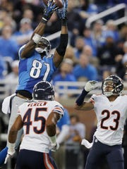 Lions receiver Calvin Johnson, defended by Bears cornerback Kyle Fuller (23), catches a 25-yard touchdown during the first half Nov. 27, 2014.