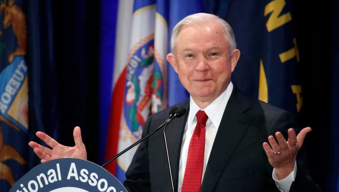 In this Feb. 28, 2017, photo, Attorney General Jeff Sessions pauses while speaking at the National Association of Attorneys General annual winter meeting in Washington. Sessions had two conversations with the Russian ambassador to the United States during the presidential campaign. The Justice Department said March 1 that the two conversations took place last year when Sessions was a senator.