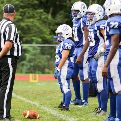 Felicia Perez stands at the line of scrimmage during