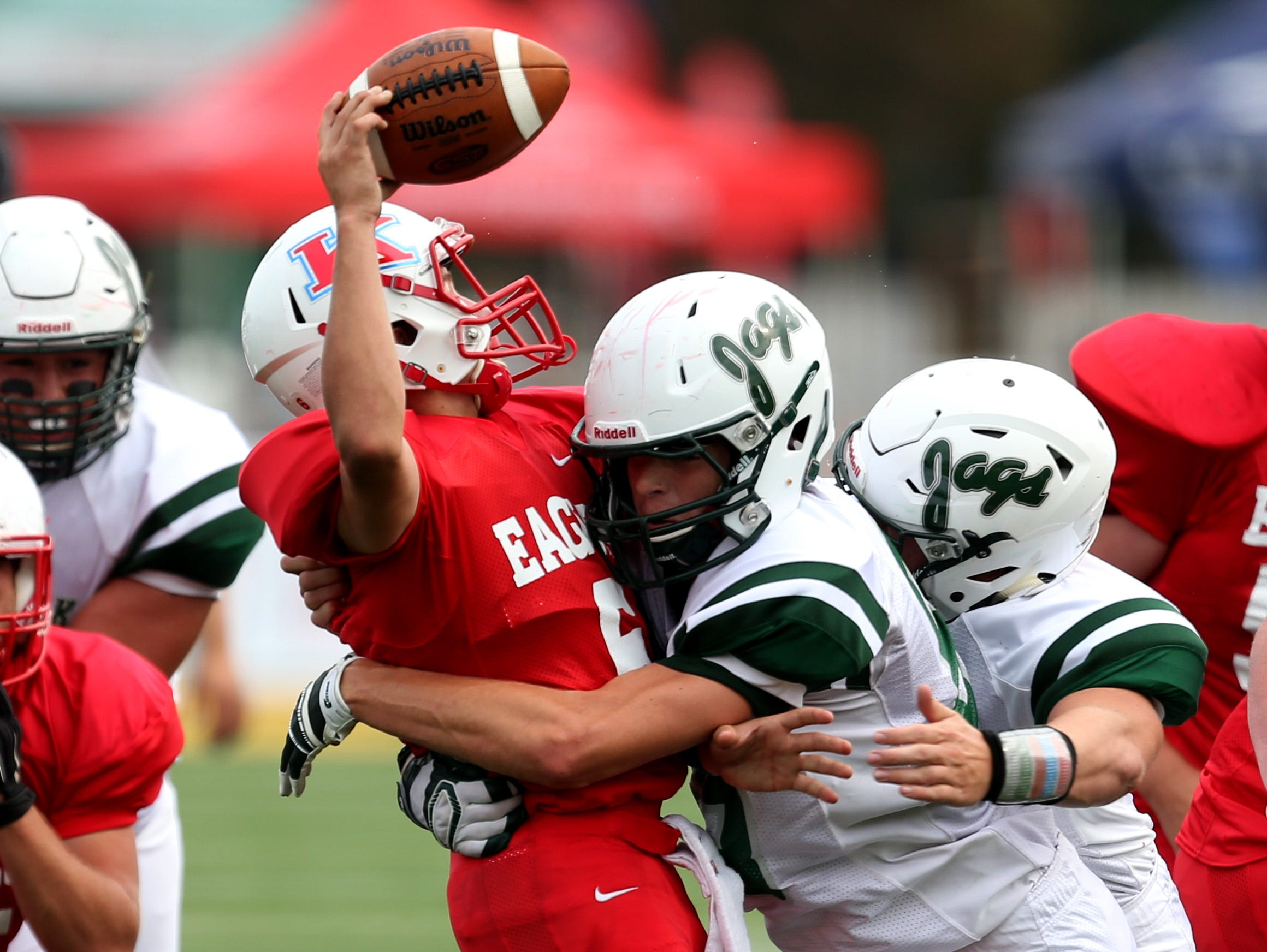 Allen Park's James Jr. Whiteford sacks Taylor Kennedy's Patrick Jackson during first-half action in the Prep Kickoff Classic on August 28, 2015 at Wayne States Tom Adams Field in Detroit Michigan.