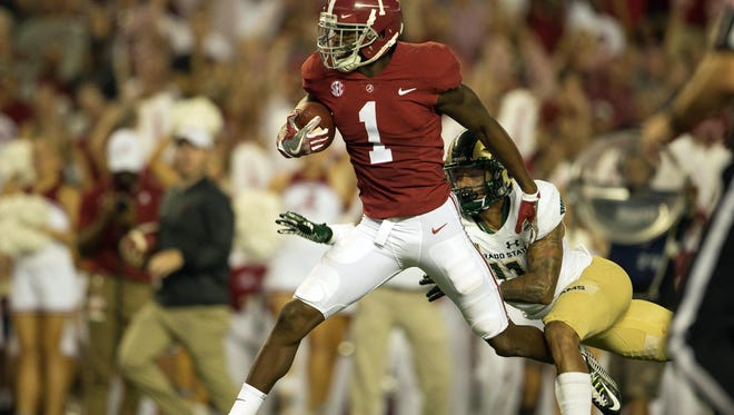 Sep 16, 2017; Tuscaloosa, AL, USA; Alabama Crimson Tide wide receiver Robert Foster (1) catches a pass and runs for a touchdown as Colorado State Rams safety Jordan Fogal (11) defends during the second quarter  at Bryant-Denny Stadium. Mandatory Credit: Marvin Gentry-USA TODAY Sports