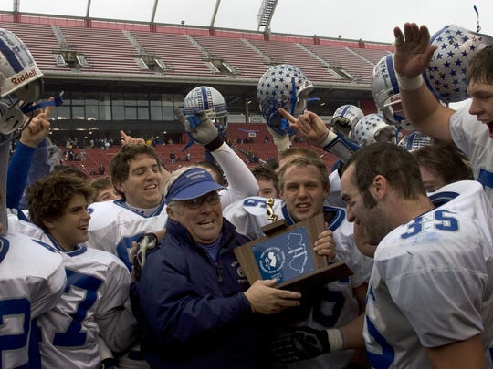 Manasquan coach Vic Kubu and his players celebrate a win over Raritan to win the Central Group II championship in 2005.