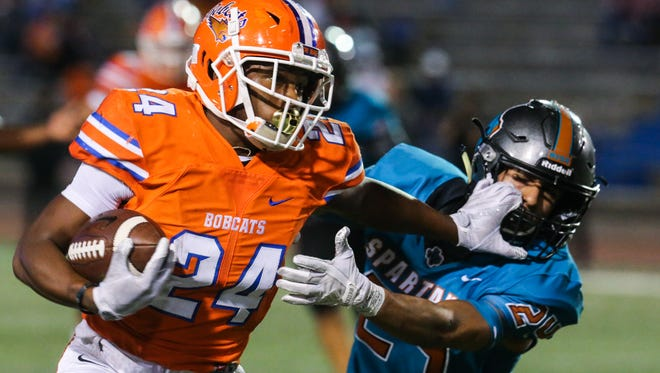 Central's Demarcus Cobb runs the ball during the Class 6A Division II bidistrict playoff against Pebble Hills Friday, Nov. 17, 2017, at San Angelo Stadium.
