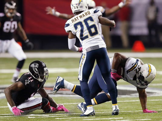 San Diego Chargers inside linebacker Denzel Perryman (52) picks off the ball intended for Atlanta Falcons wide receiver Julio Jones (11) during the second half of an NFL football game, Sunday, Oct. 23, 2016, in Atlanta. (AP Photo/John Bazemore)