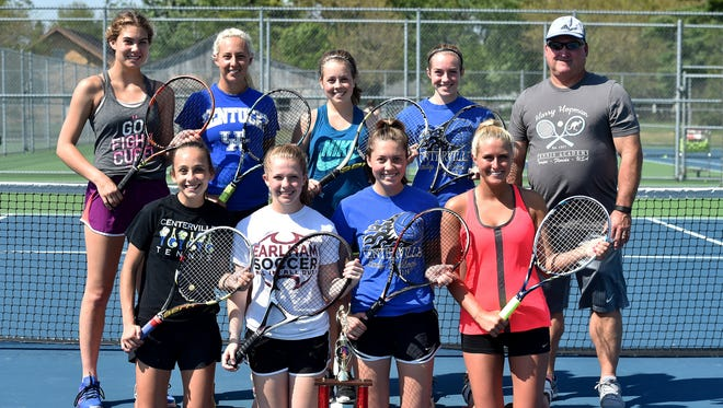 Centerville High School tennis players Addie Walther, left, Chloe Uphaus, Abby Stewart, Morgan Toschlog, Coach Randy Ecker, front-left, Katy Stewart, Morgan Guenther, Lizzy Walther and Shelby Good pose for a photo during practice Wednesday, April 26, 2017 in Centerville.