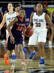A big smile comes across Blackman's Crystal Dangerfield's face as she looks up at the clock as it counts down the final moments on the clock in the second overtime period against Oakland during the TSSAA Division 1 Class AAA BlueCross Basketball Championship game, on Sunday March, 8, 2015.
