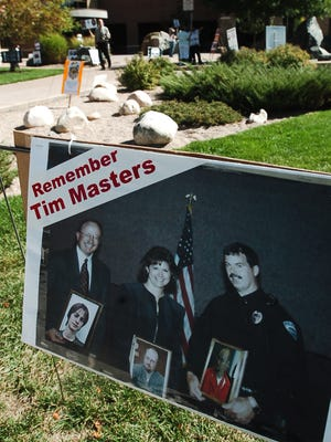 A protest sign put up by supporters of Tim Masters sits outside of the Larimer County Justice Center as they attend a status hearing for Fort Collins Police detective Jim Broderick Tuesday Sept. 28, 2010.