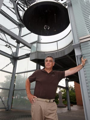 Jack Moreland stands by the World Peace Bell in Newport.