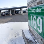The gas price at Pump n Munch can be seen while drivers get ready to buy gas Friday, Jan. 29, 2016, in Neenah, Wis.