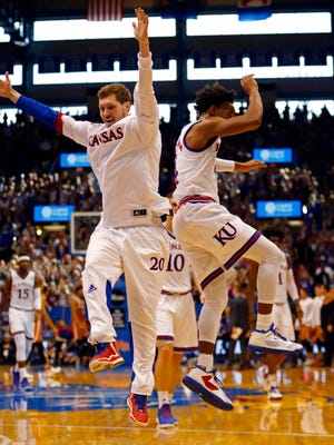 Kansas Jayhawks guards Tyler Self (20) and DevonteÕ Graham (4) celebrate during the first half of the game against the Texas Longhorns at Allen Fieldhouse.