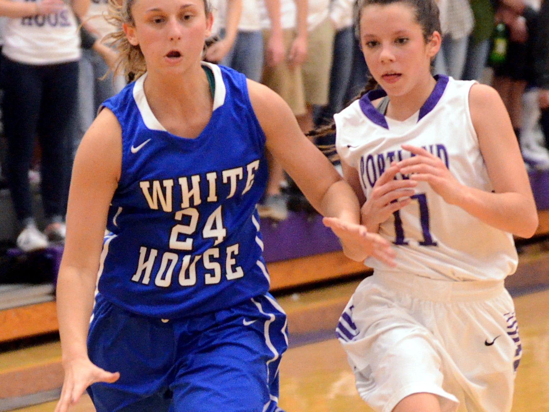White House High junior forward Hailee Ellis dribbles to the basket during third-quarter action as Portland sophomore Rachel Jennings pursues. Ellis scored eight points.