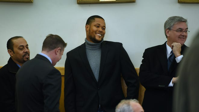 Mets closer Jeurys Familia (C) smiles prior to his second appearance in Fort Lee Municipal Court on December 15th, 2016. Charges against him were dismissed.