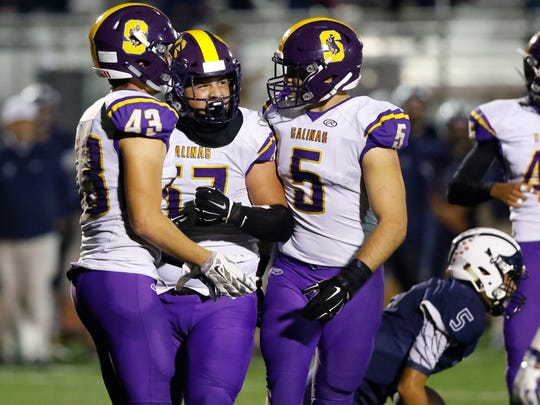 Salinas' Sebastian Gomez (57) celebrates with Alex Guerrero (43) and Drew Schuler (5) after his solo sack of Aptos' Hunter Matys during an CCS conference football game between the Salinas Cowboys and the Aptos Mariners at Aptos High School on Friday, November 3. 2017 in Aptos, Calif. Vernon McKnight/for The Californian