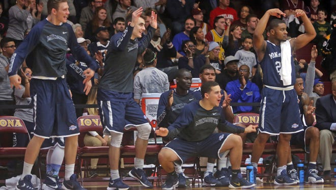 Monmouth players celebrate during the second half of Friday night's win at Iona.