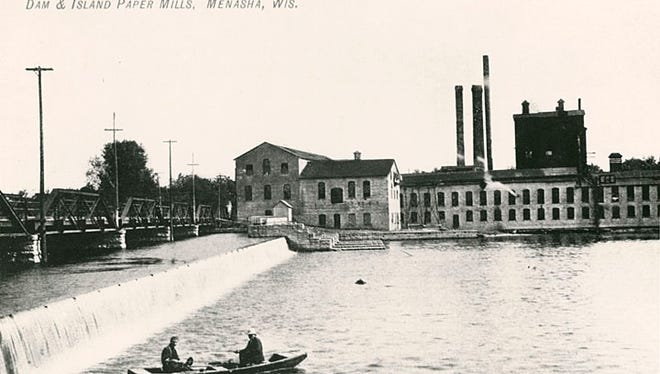 This undated photograph shows the Island Paper Mill, the dam and the Mill Street bridge.