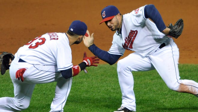 Nick Swisher, left, and Mike Aviles celebrate their win over the White Sox.