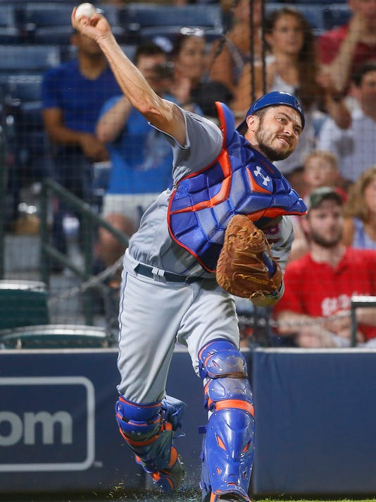 New York Mets catcher Travis d'Arnaud throws out Atlanta Braves' Jace Petterson after a dropped  third strike in the ninth inning of a baseball game Friday, June 24, 2016, in Atlanta. (AP Photo/John Bazemore)