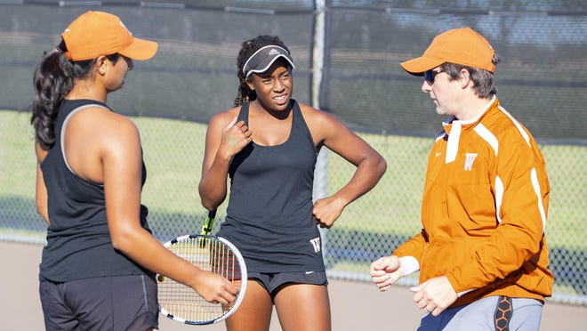 Westwood tennis coach Travis Dalrymple, right, talks to Kiana Graham, center, and Tanvi Jankay during the 2018 team tennis state tournament. Westwood, ranked No. 1 in the state by the Texas Tennis Coaches Association, won the District 25-6A tournament last week and advanced to the second round of the playoffs with a win over Austin High Monday.