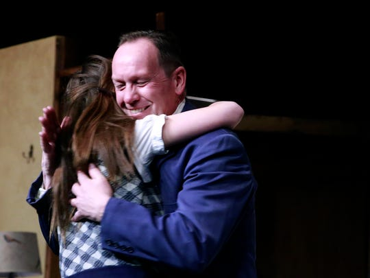 """Joel Irvin embraces Alice Ivin during a rehearsal of the San Juan College Theatre production of """"The Diary of Anne Frank"""" on Feb. 25 at the Little Theatre on the SJC campus."""
