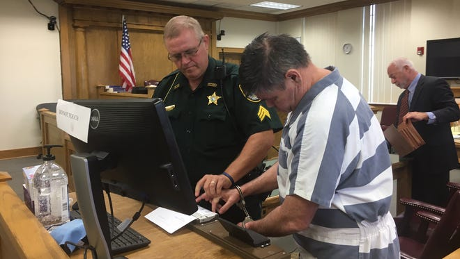 Michael Phillips is fingerprinted in a Hardee County courtroom after being sentenced to life in prison for DUI manslaughter on Friday, Oct. 13, 2017. Defense attorney Kelley Collier is in the background.