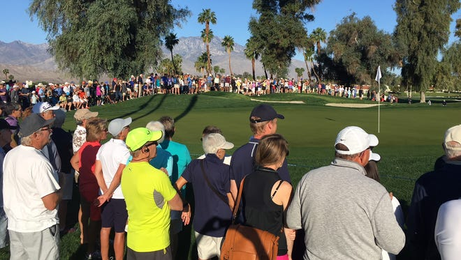 A large crowd rings the 10th green Monday morning during the ANA Inspiration two-person playoff.