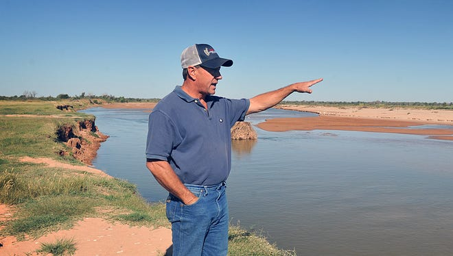 Wilbarger County farmer and rancher Ken Aderholt stands on his land that runs along the Red River. Federal District Judge Reed O'Connor recently ruling in a Motion to Compel that the Bureau of Land Management can access disputed lands along the Red River through the property owners' primary access point to get to the river for survey purposes.