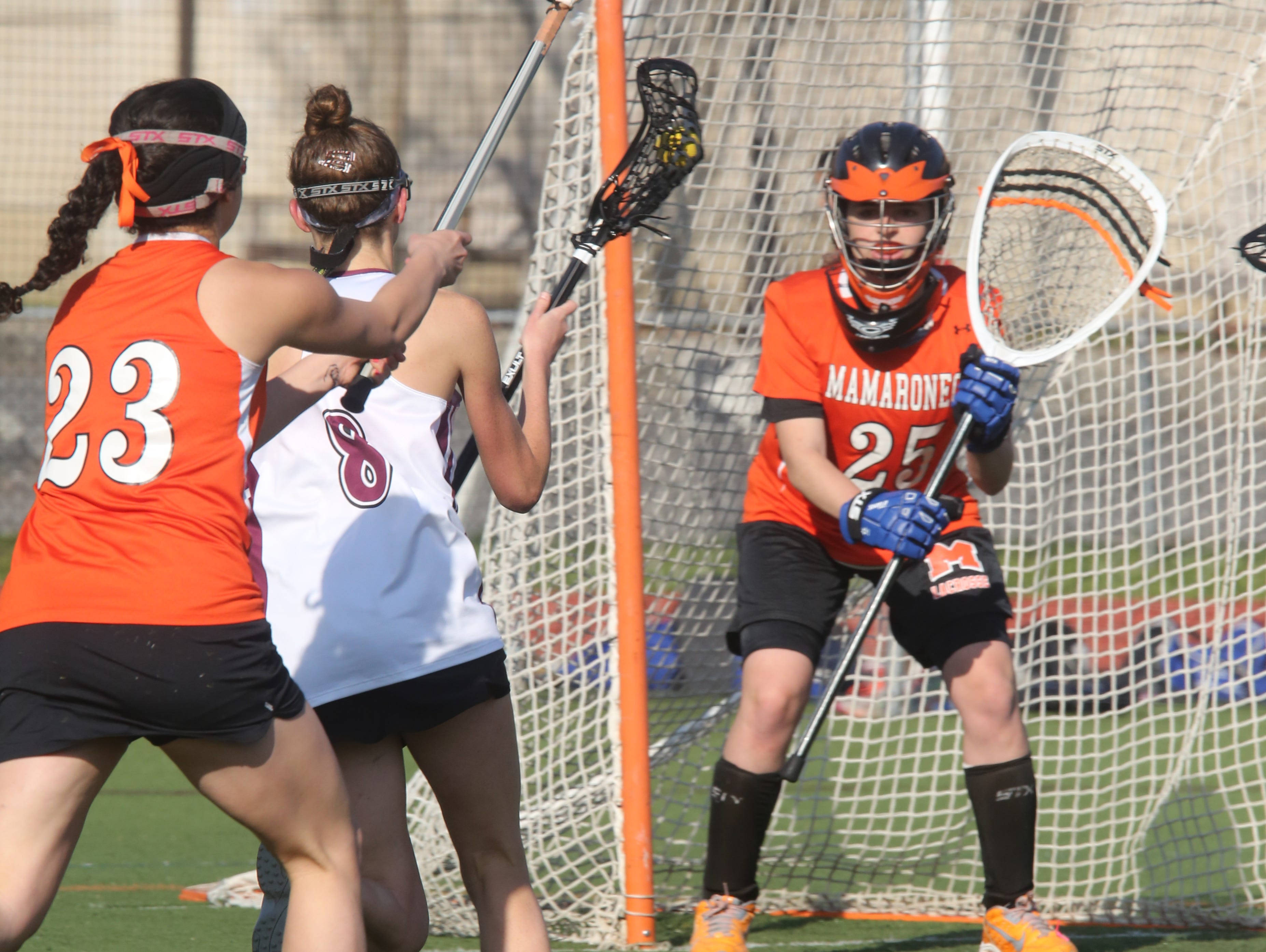 Mamaroneck's Talia Land (25) guards the net against Scarsdale during girls lacrosse game at Scarsdale High School on April 27, 2016. Mamaroneck defeats Scarsdale 9-7.