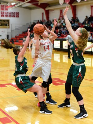 Bellevue's Casey Santoro looks to score among three Oak Harbor defenders.