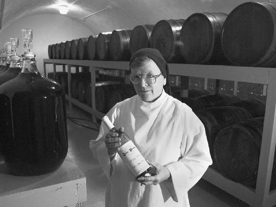Surrounded by casks and carboys, sister Donald Corcoran