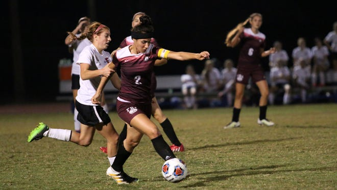 First Baptist captain Natasha Rodriguez and Evangelical Christian junior Victoria Valentine struggle for possession during the Girls 1A-8 District Championship at Community School of Naples on Friday, Jan. 20, 2017.