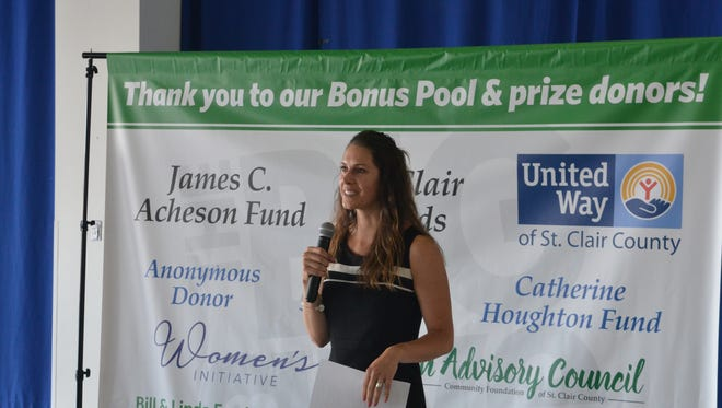 Jackie Hanton, vice president of the Community Foundation of St. Clair County, takes the mic shortly before announcing the grand total of The Big Give fundraising blitz at a celebration at Seaway Terminal in Port Huron on June 13, 2018, in Port Huron, Michigan.