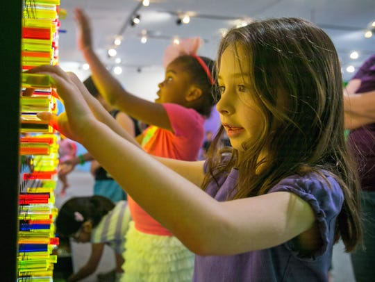 Sydney Younce, 5, plays with a light exhibit at the