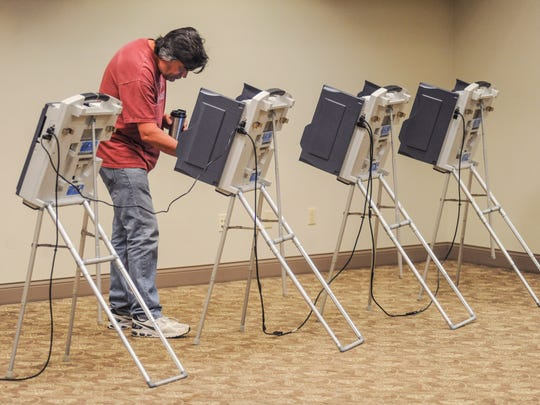 Martin Calderwood votes during the primary election