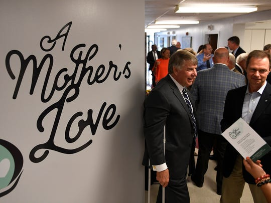 Guests mingle Wednesday, Aug. 30, 2017, after the ribbon cutting for A Mother's Love, a facility for opioid-addicted mothers at Humboldt Medical Center.