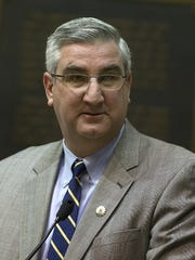 Indiana governor-elect Eric Holcomb speaks at the meeting of Indiana's 11 presidential electors to cast votes for President and Vice President of the United States, at the statehouse, Indianapolis, Monday, Dec. 19, 2016.