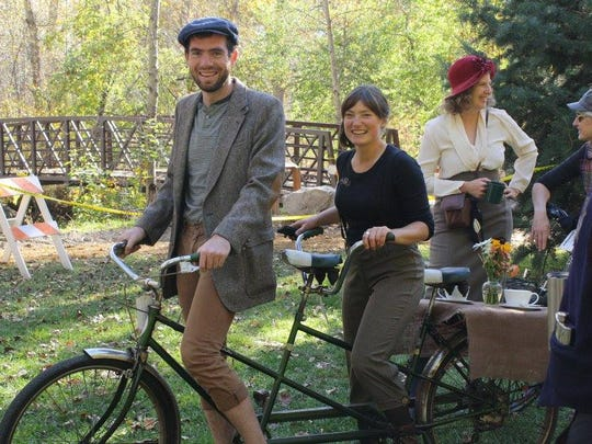 A couple attached a tea table to their tandem bicycle for the Missoula Tweed Ride.