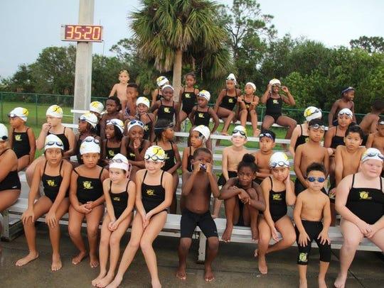 Students from the Treasure Coast Swim Club wait to