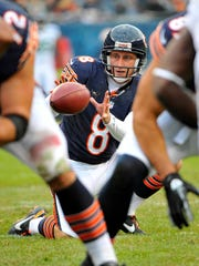 Adam Podlesh, shown holding a snap for the Bears in 2012, punted four seasons with Jacksonville and three more with Chicago.