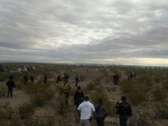 Mexican law enforcement officers search the Navajo