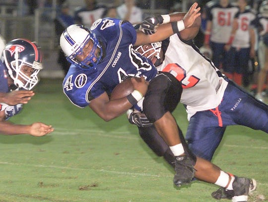 Godby's Damion McGriff (40) dives into the endzone