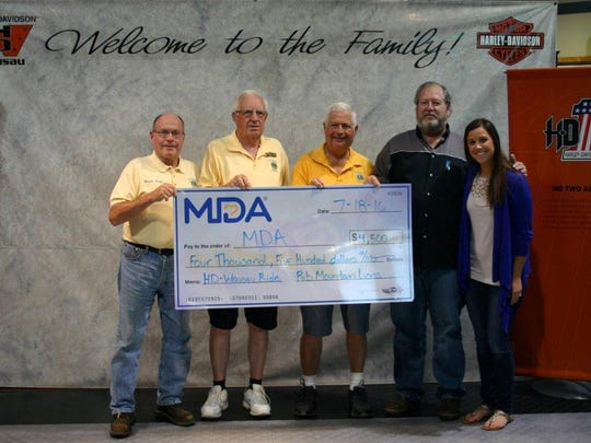 The Rib Mountain Lions recently donated $4,500 to the MDA. The funds were raised by the Lions while providing food and beverages in conjunction with the annual MDA ride sponsored by Harley-Davidson of Wausau. Pictured, from right to left, are Lauren Nelsen, representing the MDA, Doug Locke, owner of Harley-Davidson of Wausau and member of the Rib Mountain Lions, and Lions Doug Doede, Dorn Ward and Phil Bickley.