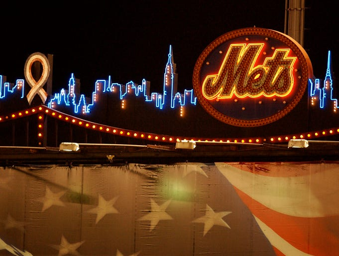 The neon skyline of New York shines on the scoreboard in Shea Stadium on September 21, 2001 with a ribbon over the rendering of the World Trade Center towers.  The Mets  played their first home game after the attack on the World Trade Center.