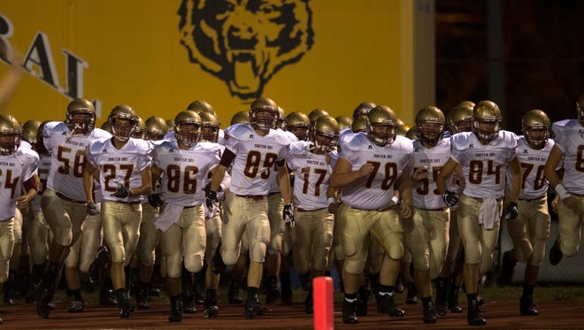 Mater Dei takes the field before their game against Central at Central Stadium Friday night.