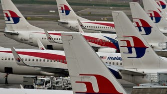 Malaysia Airlines planes at the Kuala Lumpur International Airport on June 17, 2014.